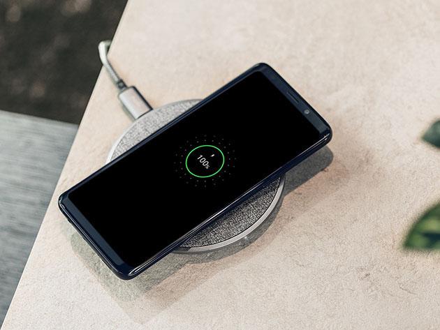 A phone charging pad, charging a phone