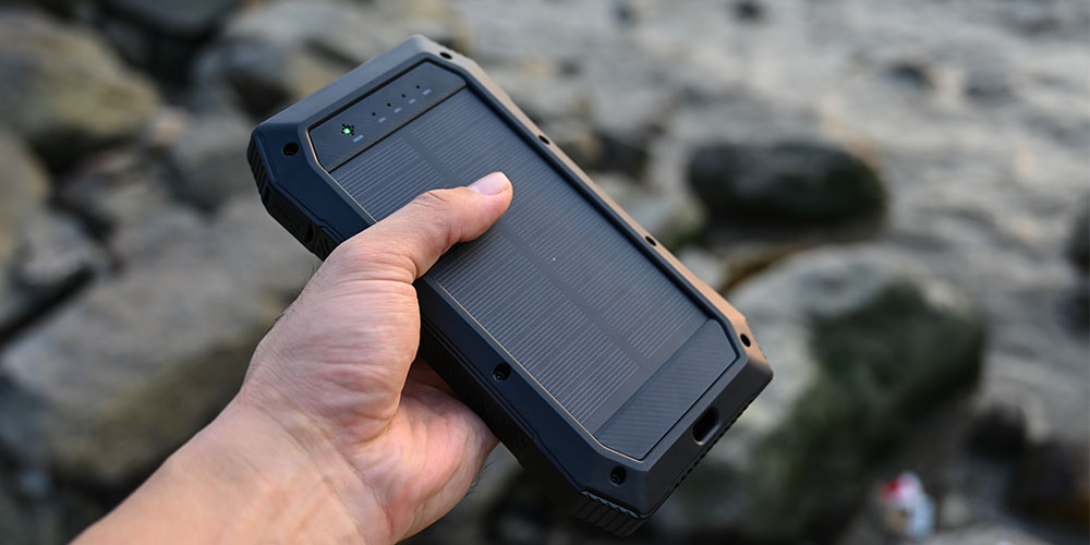 A person holding a solar powered wireless charger
