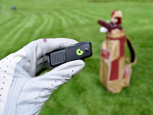 A person using a golf GPS Rangefinder.