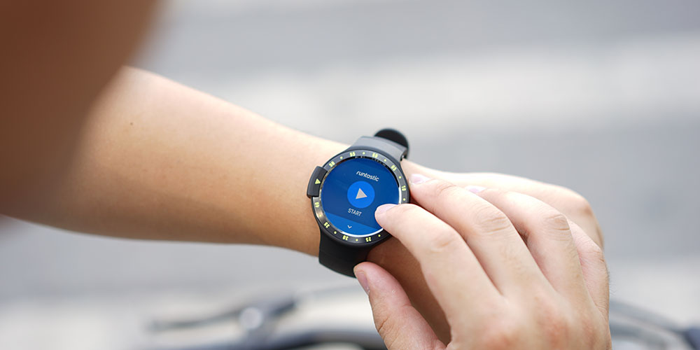 A person tapping their smart watch