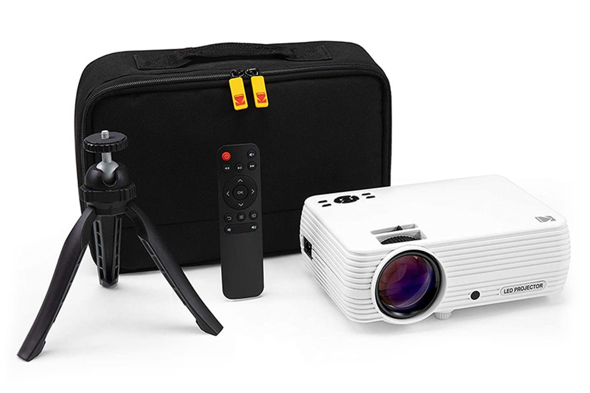 Kodak projector with case, remote, and tripod