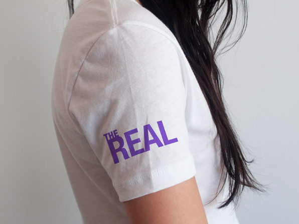 'The Real' Arm Logo White V-Neck T-Shirt