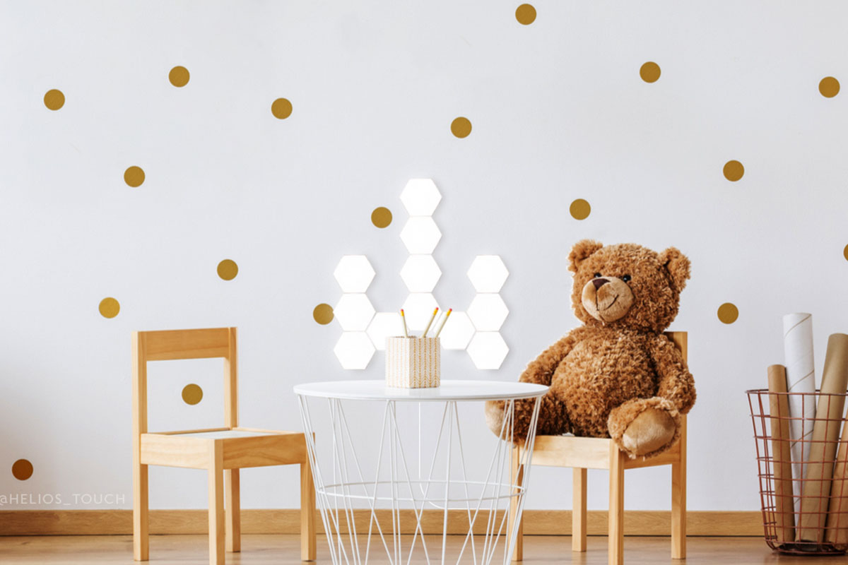 A children's room with a table, chairs and teddy bear.