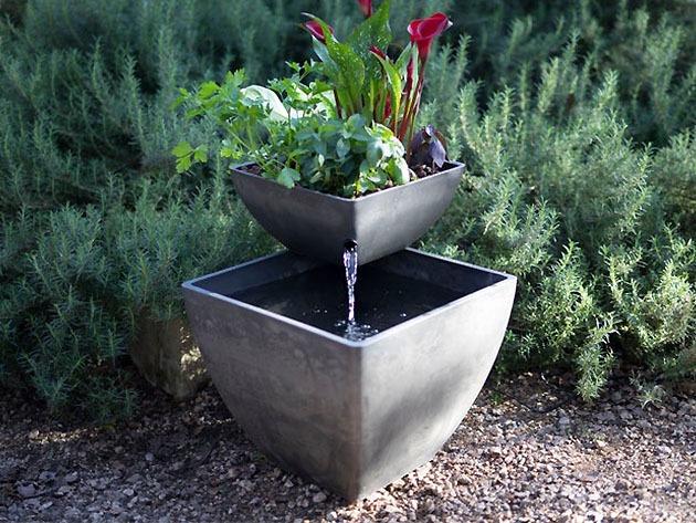 An aquaponics garden planter outside