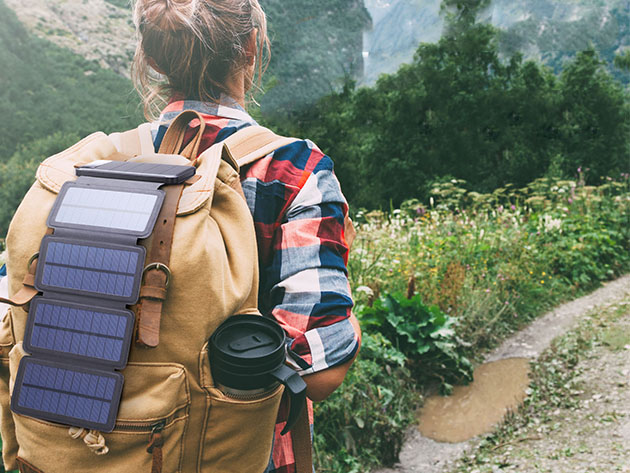 A person hiking with a solar charger attached to their backpack