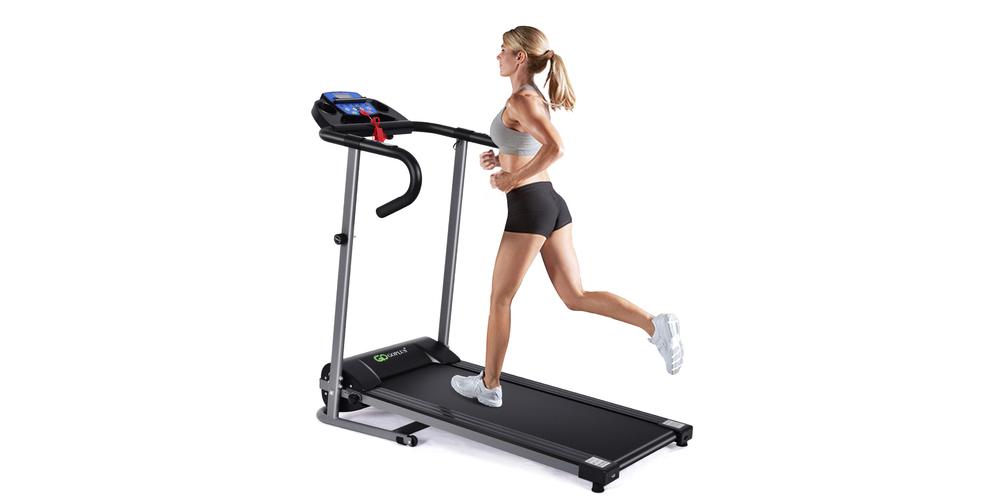 A woman runs on a black elevated treadmill