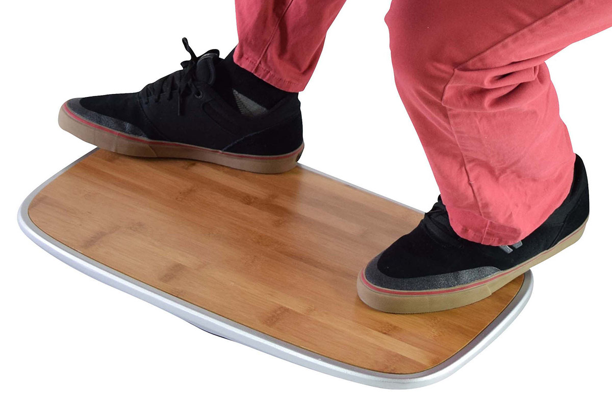 A person standing on a balancing board.