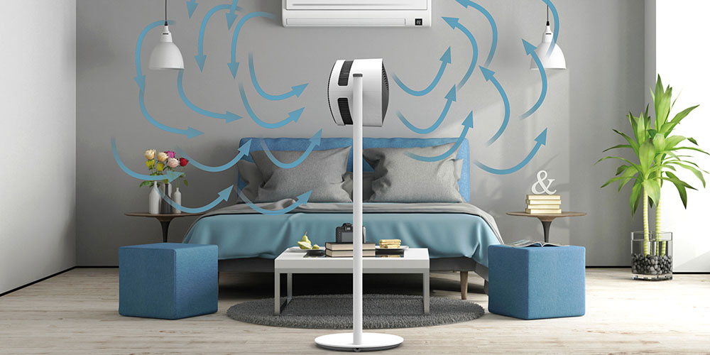 A demonstration of a fan cooling a bedroom