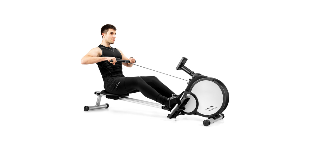 A man sits on a rowing machine